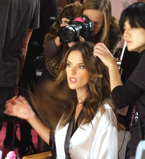 Model Alessandra Ambrosio is made up backstage at the Victoria's Secret fashion show in London, Tuesday, December 2, 2014. (Photo by Dejan Jankovic/Invision/AP Photo)