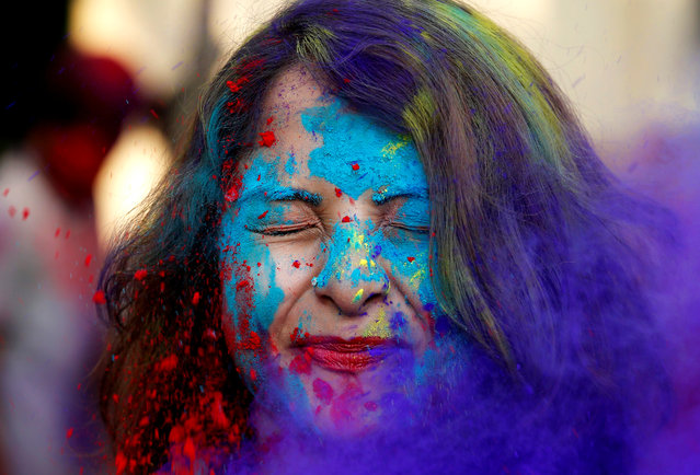 A student of Rabindra Bharati University reacts as fellow students throw coloured powder in her face during the Holi celebrations inside the university campus in Kolkata, India February 27, 2018. (Photo by Rupak De Chowdhuri/Reuters)