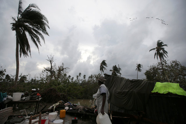 A woman stands amongst the wreckage of a house destroyed by Hurricane Matthew in Les Cayes, Haiti, October 5, 2016. (Photo by Andres Martinez Casares/Reuters)
