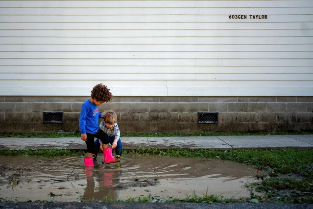 Teagan Marmion, 4, and her neighbor James Smith, 4, play in a puddle after Hurricane Zeta swept through New Orleans, Louisiana, U.S., October 29, 2020. (Photo by Kathleen Flynn/Reuters)