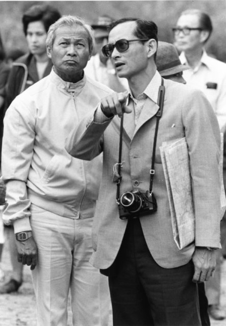 King Bhumibol talks with Thailand Prime Minister Gen. Prem Tinsulanonda as they visit an irrigation project in Northern Thailand recently, February 16, 1981. Gen. Prem helped the King play host to visiting foreign ambassadors from Bangkok. (Photo by AP Photo)