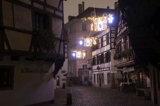 Christmas lightings are pictured where the Christmas market usually takes place, Friday, November 27, 2020 in Strasbourg, eastern France. Due to the COVID-19 pandemic, the well-known festive market will not be taking place this year. (Photo by Jean-Francois Badias/AP Photo)