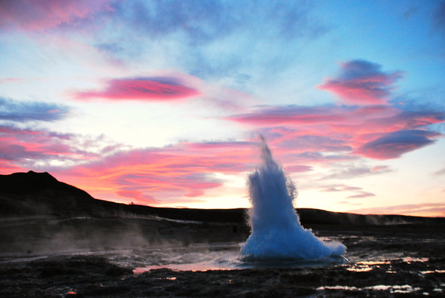 Strokkur geyser against cloudy sky at sunset. Strokkur is a fountain geyser located in a geothermal area beside the Hvítá River in Iceland in the southwest part of the country, east of Reykjavík. It is one of Iceland's most famous geysers, erupting once every 6–10 minutes. Its usual height is 15–20 m, although it can sometimes erupt up to 40 m high. (Photo by Teatsche Dijkhuis/Getty Images/EyeEm)