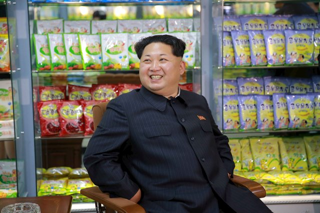 North Korean leader Kim Jong Un smiles while sitting during a visit to inspect the Pyongyang Children's Foodstuff Factory, in this undated photo released by North Korea's Korean Central News Agency (KCNA) on November 14, 2015. (Photo by Reuters/KCNA)