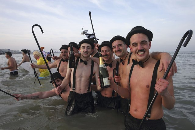 People wearing costumes participate in a traditional New Year's Day swim in Malo-les-Bains, northern France January 1, 2015. (Photo by Pascal Rossignol/Reuters)