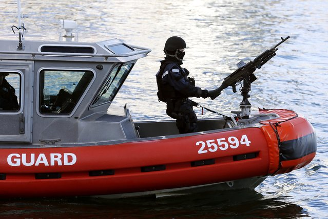 A U.S. Coast Guard boat patrols on Boston Harbor outside the federal courthouse in Boston, Monday, January 5, 2015, for the first day of jury selection in the trial of Boston Marathon bombing suspect Dzhokhar Tsarnaev. The courthouse was under tight security Monday, with dozens of police officers inside and outside the building. (Photo by Michael Dwyer/AP Photo)