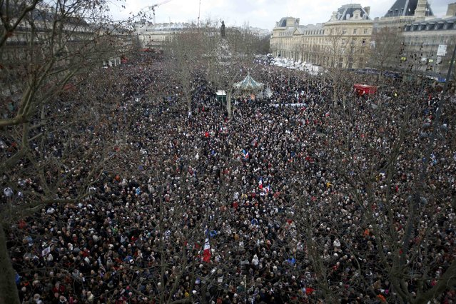 Hundreds of thousands of people gather on the Place de la Republique to attend the solidarity march (Rassemblement Republicain) in the streets of Paris January 11, 2015. (Photo by Charles Platiau/Reuters)
