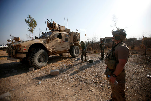 U.S. military vehicles are seen in the town of Bashiqa, east of Mosul, during an operation to attack Islamic State militants in Mosul, Iraq, November 7, 2016. (Photo by Azad Lashkari/Reuters)