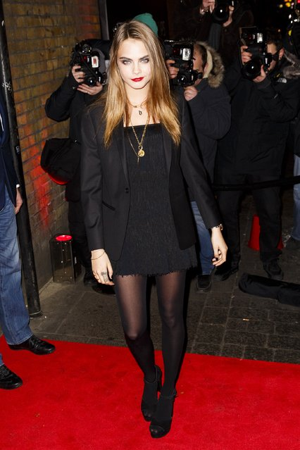 Cara Delevingne attends the YSL Beauty: YSL Loves Your Lips party at The Boiler House,The Old Truman Brewery, on January 20, 2015 in London, England. (Photo by Tristan Fewings/Getty Images)