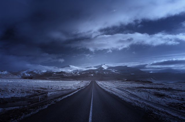 Straight road through ingvellir southwestern Iceland. (Photo by Andy Lee/Caters News)