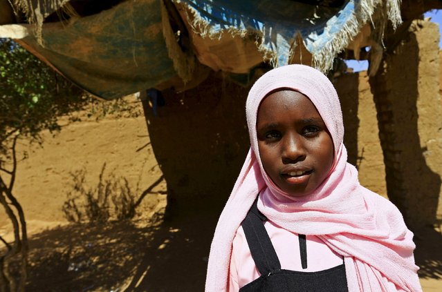 Manasik Yousif Abdo-Rahman, a 4th grader at the Alsalam camps for the internally displaced persons poses for a photograph in El-Fasher in North Darfur, Sudan, November 17, 2015. Born in the camp, 12-year-old Abdo-Rahman wishes to be an electric engineer in her adulthood. (Photo by Mohamed Nureldin Abdallah/Reuters)
