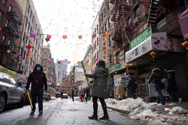 Joseph Graziano and Alexa Lee celebrate Lunar New Year and Valentine's Day with confetti in Chinatown, during the coronavirus disease (COVID-19) pandemic, in the Manhattan borough of New York City, New York, U.S. February 14, 2021. (Photo by Caitlin Ochs/Reuters)