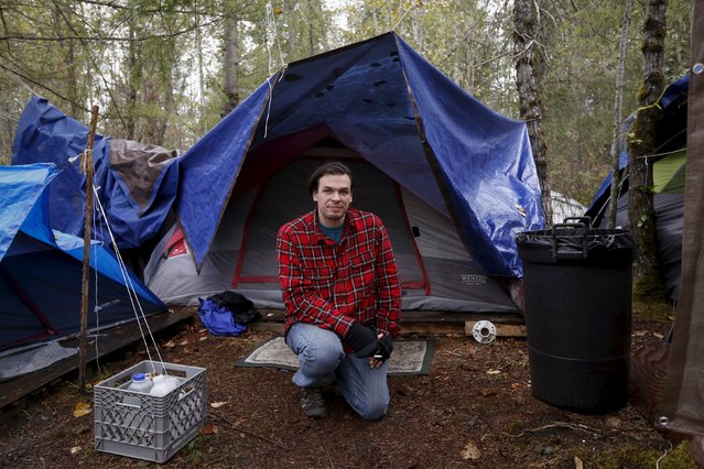 "Stephan Schleicher, 31, poses in front of his tent at SHARE/WHEEL Tent City 4 outside Seattle, Washington October 9, 2015. ""There is a community here and a sense of people being held accountable to each other"", Schleicher said. (Photo by Shannon Stapleton/Reuters)"