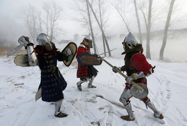 "Members of the ""Avalon"" team wearing 14th century knight costumes fight against each other on the bank of the Yenisei River during the regional amateurs tournament of clubs of historical reconstruction, ""The Battle of the Nations 2015. Siberia"", in Krasnoyarsk January 24, 2015. (Photo by Ilya Naymushin/Reuters)"