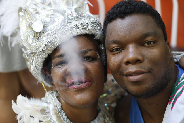 "Patients from the Nise de Silveira mental health institute pose for a portrait during the institute's carnival parade, coined in Portuguese: ""Loucura Suburbana"", or Suburban Madness, at the center in Rio de Janeiro, Brazil, Thursday, February 12, 2015. (Photo by Silvia Izquierdo/AP Photo)"