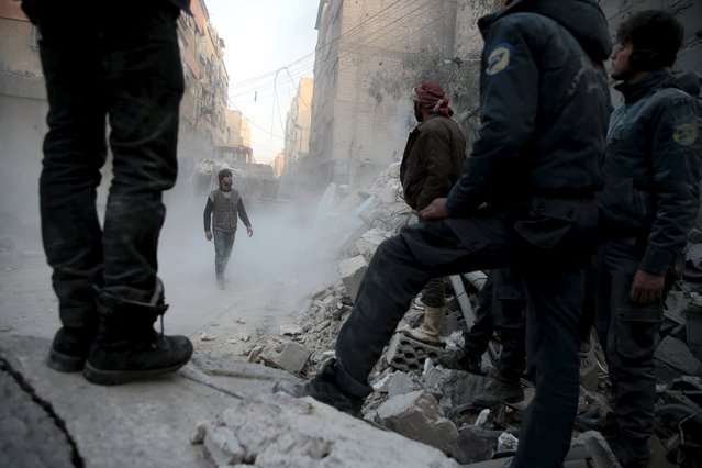 Residents look for survivors in a site hit by what activists said were airstrikes carried out by the Russian air force in the town of Douma, eastern Ghouta in Damascus, Syria January 10, 2016. (Photo by Bassam Khabieh/Reuters)
