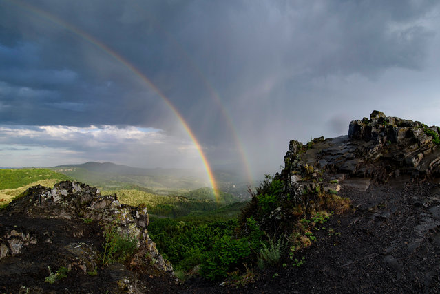 A rainbow is seen from the Witch Stone after a heavy downpour near Salgotarjan, Hungary, 01 June 2020 (issued 02 June 2020). (Photo by Peter Komka/EPA/EFE)