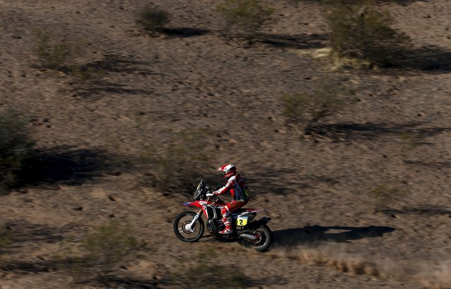Paulo Goncalves of Portugal rides his Honda during the ninth stage of the Dakar Rally 2016 near Belen, Argentina, January 12, 2016. (Photo by Marcos Brindicci/Reuters)