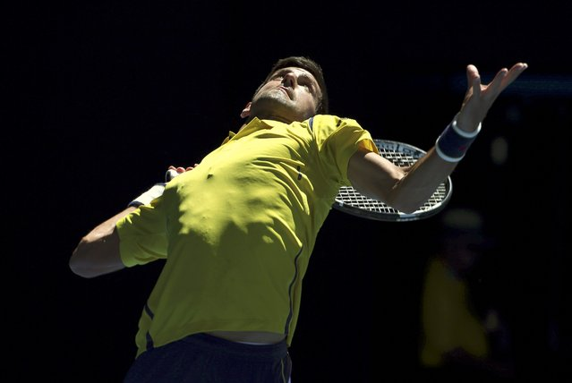 Serbia's Novak Djokovic serves during his first round match against South Korea's Hyeon Chung at the Australian Open tennis tournament at Melbourne Park, Australia, January 18, 2016. (Photo by Jason O'Brien/Reuters)