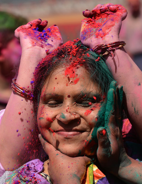 Members of the Nepalese ethnic Madhesi community daub each other's faces with coloured powders during Holi festival celebrations in Kathmandu on March 6, 2015. The Holi festival of colours is a riotous celebration of the coming of spring and falls on the day of the full moon in March every year. AFP PHOTO / PRAKASH MATHEMA        (PRAKASH MATHEMA/AFP/Getty Images)