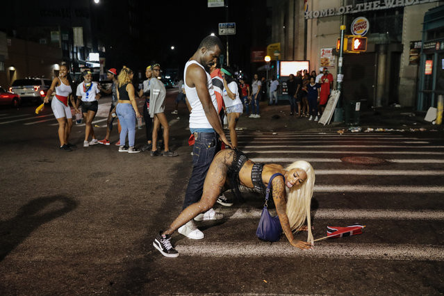 Revelers participate in J'Ouvert, an overnight celebration the night before the West Indies Day Parade in Brooklyn, NY on September 3, 2018. Violence in past years led NYPD to shut down the parade route until 2am, which caused revelers to travel down to the Flatbush neighborhood. (Photo by Stephen Yang)