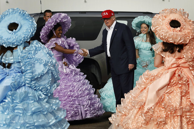 U.S. President-elect Donald Trump greets a group of gathered Azalea Trail Maids as he arrives for stop on his USA Thank You Tour event in Mobile, Alabama, U.S., December 17, 2016. (Photo by Lucas Jackson/Reuters)