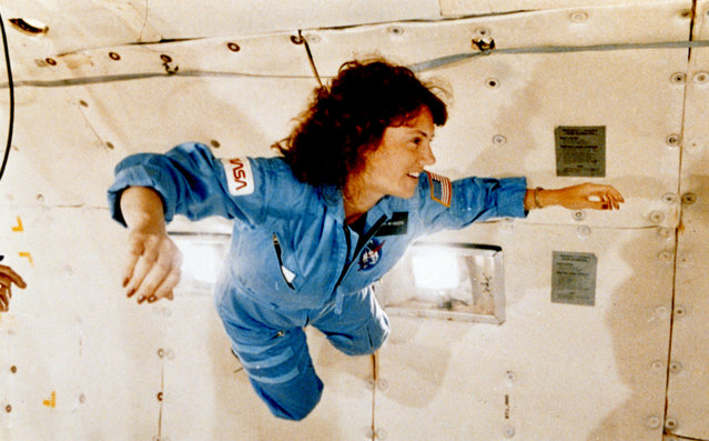 """Christa McAuliffe gets a preview of microgravity on NASA's specially equipped KC-135 """"zero gravity"""" aircraft on January 13, 1986. The plane flies in a parabolic pattern that provides short periods of weightlessness. For some people, those bouts of zero-G can induce nausea – which is why the airplane was nicknamed the """"Vomit Comet"""". (Photo by Getty Images/Science & Society Picture Library)"""