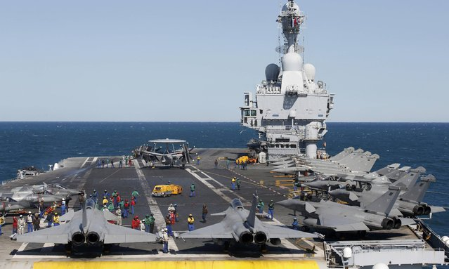 Rafale fighter jets, Super Etendards and a E2C Hawkye (C) are seen aboard France's Charles de Gaulle aircraft carrier that is on a mission in the Gulf, January 28, 2016. (Photo by Philippe Wojazer/Reuters)