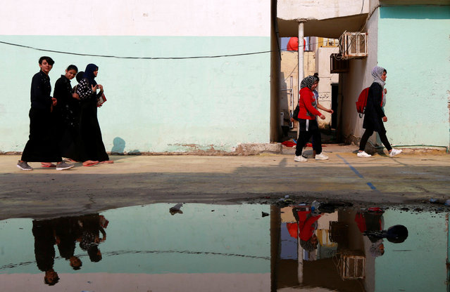 Women leave the gym after their exercise in Diwaniya, Iraq on November 10, 2018. (Photo by Alaa Al-Marjani/Reuters)