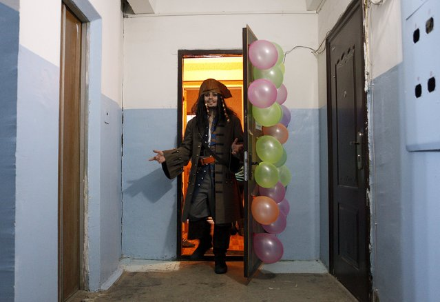 German Yesakov, 25, a cameraman from Russia, dressed as movie character Captain Jack Sparrow, gets out of his bride's flat during their wedding ceremony in the southern city of Stavropol, Russia, February 5, 2016. (Photo by Eduard Korniyenko/Reuters)