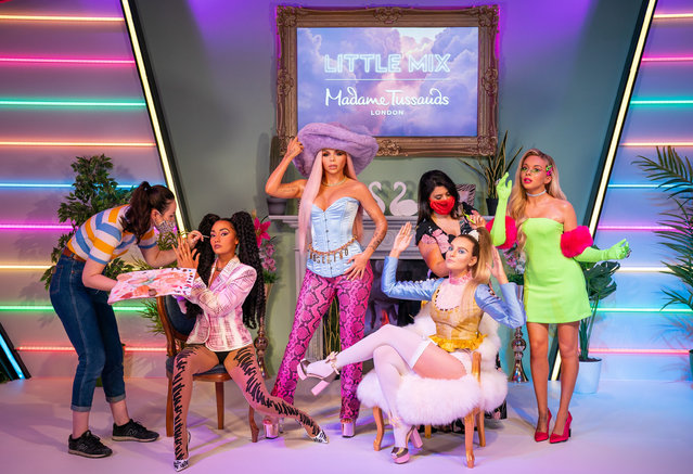 Waxworks artists retouch the wax figures at the unveiling of Little Mix waxwork figures at Madame Tussauds, in London, Britain, July 28, 2021. (Photo by Aaron Chown/PA Images via Getty Images)