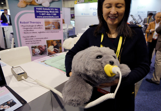 Christine Hsu shows off the Paro seal pup therapeutic robot at the Robotics Marketplace at CES in Las Vegas, U.S., January 5, 2017. (Photo by Rick Wilking/Reuters)