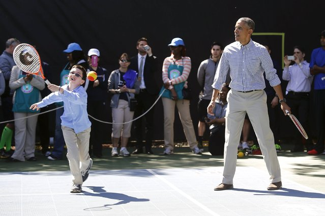 U.S. President Barack Obama plays tennis with children, one of the activities at the annual Easter Egg Roll at the White House in Washington April 6, 2015. (Photo by Jonathan Ernst/Reuters)
