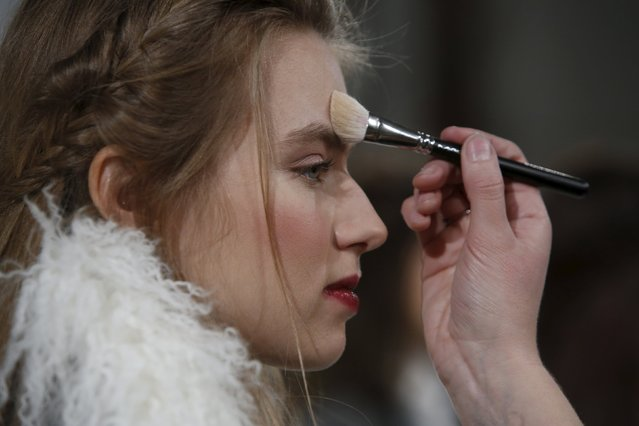 A model is prepared before presenting the Rachel Zoe Fall/Winter 2016 collection at New York Fashion Week, February 14, 2016. (Photo by Andrew Kelly/Reuters)