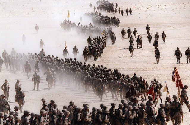 In this November 4, 1990 file photo, responding to Iraq's invasion of Kuwait, troops of the U.S. 1st Cavalry Division deploy across the Saudi desert on  during preparations prior to the Gulf War. Twenty five years after the first U.S. Marines swept across the border into Kuwait in the 1991 Gulf War, American forces find themselves battling the extremist Islamic State group, born out of al-Qaida, in the splintered territories of Iraq and Syria. (Photo by Greg English/AP Photo)