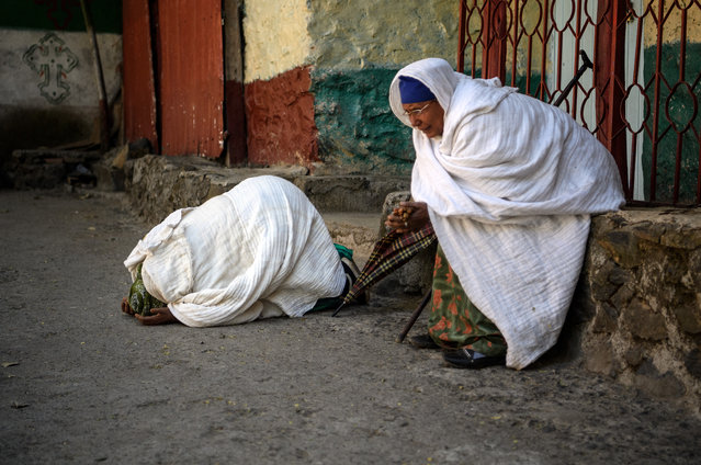 Woman pray in the grounds of a church as Timkat celebrations get under way on January 18, 2017 in Gondar, Ethiopia. (Photo by Carl Court/Getty Images)