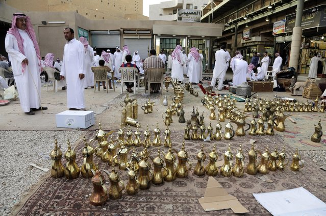 In this April 16, 2015 photo, traditional coffee pots are lined up for sale at al-Aqeeliya open-air auction market in Riyadh, Saudi Arabia. (Photo by Hasan Jamali/AP Photo)