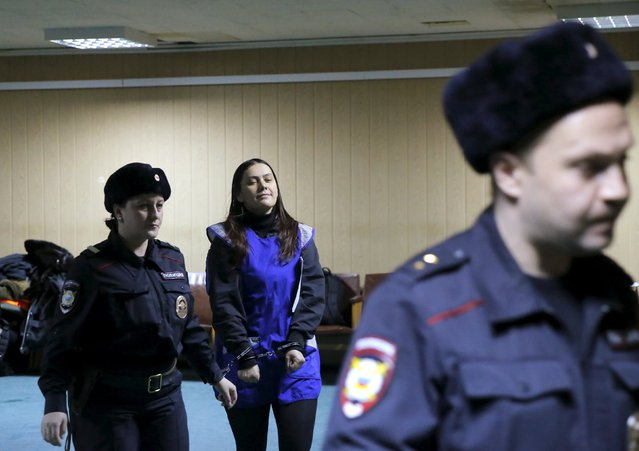 Gulchekhra (Gyulchekhra) Bobokulova, a nanny suspected of murdering a child in her care, is escorted inside a court building in Moscow, Russia, March 2, 2016. (Photo by Maxim Shemetov/Reuters)