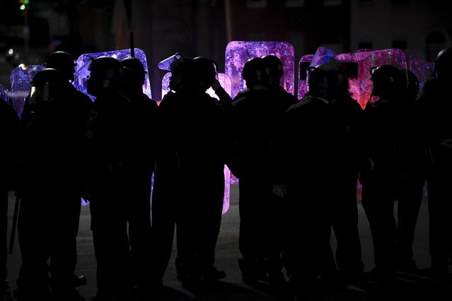 Law enforcement officers stand guard near Baltimore Police Department Western District during a protest against the death in police custody of Freddie Gray, in Baltimore April 25, 2015. (Photo by Sait Serkan Gurbuz/Reuters)