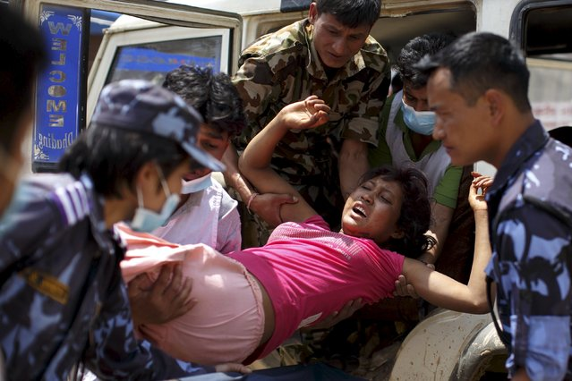 Military personnel and volunteers carry an injured woman into Dhading hospital, in the aftermath of Saturday's earthquake, in Dhading Besi, Nepal April 27, 2015. (Photo by Athit Perawongmetha/Reuters)