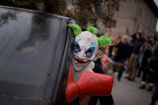A masked reveller looks out from a car during carnival celebrations in Ituren, northern Spain January 30, 2017. (Photo by Vincent West/Reuters)