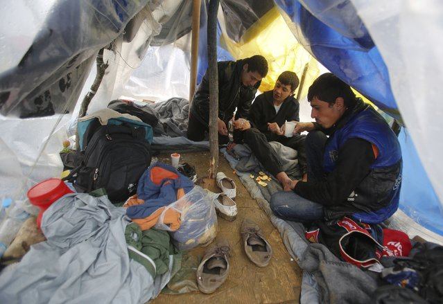 Migrants rest inside their tent at a makeshift camp on the Greek-Macedonian border, near the village of Idomeni, Greece March 10, 2016. (Photo by Stoyan Nenov/Reuters)