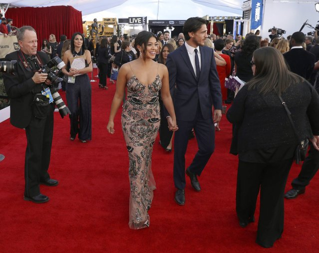Gina Rodriguez, left, and Joe LoCicero arrive at the 23rd annual Screen Actors Guild Awards at the Shrine Auditorium & Expo Hall on Sunday, January 29, 2017, in Los Angeles. (Photo by Matt Sayles/Invision/AP Photo)