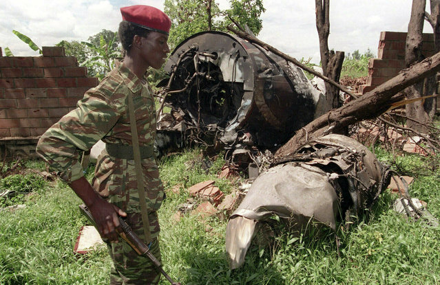In this May 23, 1994, file photo, a Rwandan Patriotic Front (RPF) rebel walks by the plane wreckage in which Rwanda's President Juvenal Habyarimana died April 6, 1994, in Kigali, Rwanda. Twenty-five years ago Rwanda descended into violence in which some 800,000 Tutsis and moderate Hutus were massacred by the majority Hutu population over a 100-day period in what was the worst genocide in recent history. (Photo by Jean-Marc Bouju/AP Photo/File)