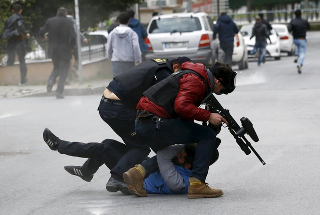 Riot police detain a pro-Kurdish demonstrator during a gathering to celebrate the spring festival of Newroz despite of a ban from the governorship, in Istanbul, Turkey March 20, 2016. (Photo by Murad Sezer/Reuters)