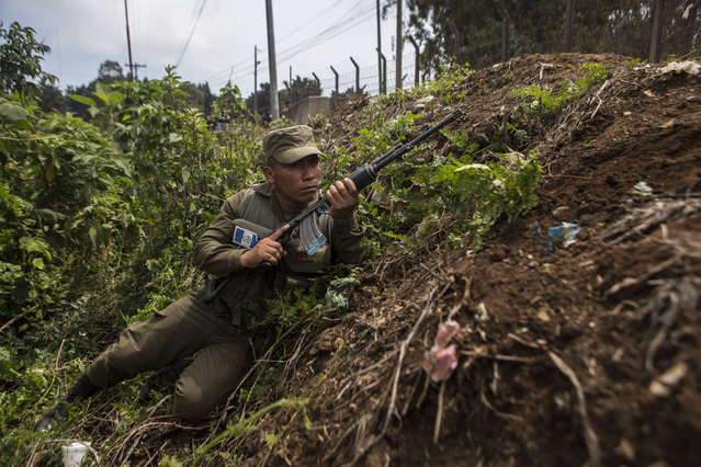 A soldier takes position outside the Pavon Rehabilitation Model Farm after a shooting inside the prison in Fraijanes, Guatemala, Tuesday, May 7, 2019. At least three people were killed and 10 people were wounded in the shooting, authorities said. (Photo by Oliver De Ros/AP Photo)