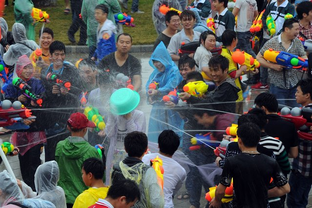 """This picture taken on March 2, 2014 shows people celebrating mai-shen festival, literally """"selling yourself festival"""" in the township of Dongkeng in Dongguan municipality, south China's Guangdong province. The festival, also called """"yu xian festival"""" which means """"a festival to meet the immotal"""", dates back to late Ming dynasty in Dongkeng. (Photo by AFP Photo)"""