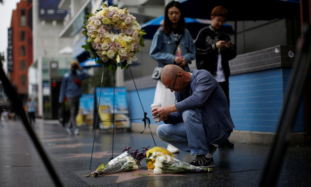 A person kneels by the star of late actor Doris Day on the Hollywood Walk of Fame in Los Angeles, California, U.S., May 13, 2019. (Photo by Mario Anzuoni/Reuters)