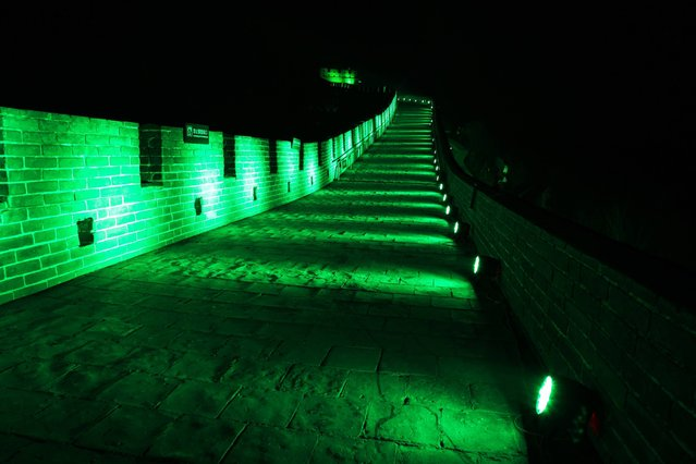 "In a major coup for Irish tourism, the Great Wall of China became the ""Green Wall of China"" this evening (at midnight in China), joining a host of other sites around the world for Tourism Ireland's 2014 Global Greening initiative, to celebrate the island of Ireland and St Patrick this weekend. (Photo by Tourism Ireland)"
