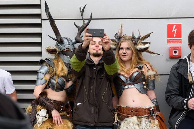 People in costume take a selfie at the 2016 Pyrkon Festival, a multigenre fantasy convention, in Poznan, Poland, April 9, 2016. Pyrkon is one of the biggest conventions and gaming events in Europe. The festival runs until 10 April. (Photo by Jakub Kaczmarczyk/EPA)